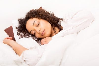 woman sleeping after post-concussion syndrome