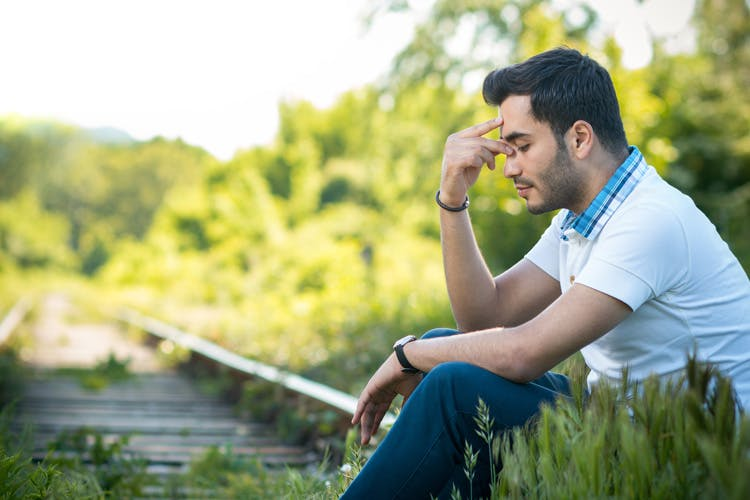 stressed man struggling with traumatic brain injury anxiety disorders like ptsd