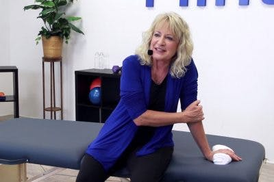 physical therapist demonstrating shoulder exercises for stroke patients