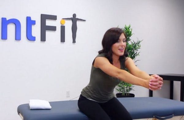Cassie, DPT, demonstrating forward punches seated core exercises for stroke patients