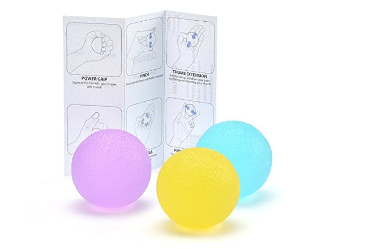 hand therapy balls with sheet of exercises behind it