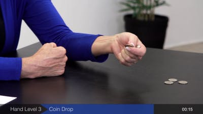 physical therapist showing how to do hand exercises