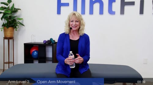 physical therapist demonstrating best exercises for arm and hands after stroke