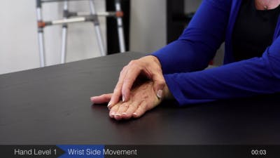 physical therapist demonstrating hand exercises for stroke patients