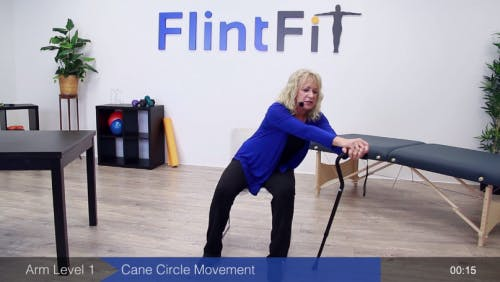 occupational therapist leaning on cane for passive exercise