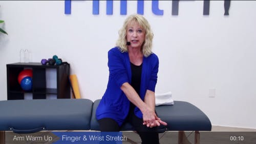 occupational therapist demonstrating passive range of motion exercises for stroke patients