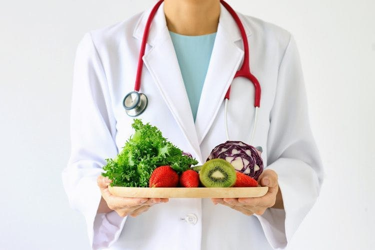 doctor with tray of healthy food to prevent a second stroke