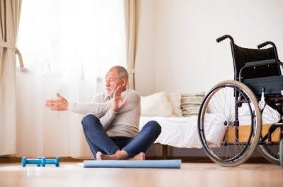 man exercising at home expecting recovery after stroke