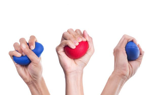 hands squeezing stress ball for hand therapy exercises