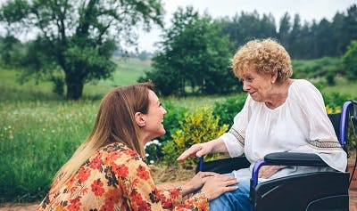 young woman talking to stroke survivor about how to manage ptsd