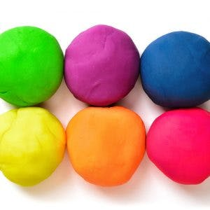 six colorful pieces of therapy putty rolled into perfect balls