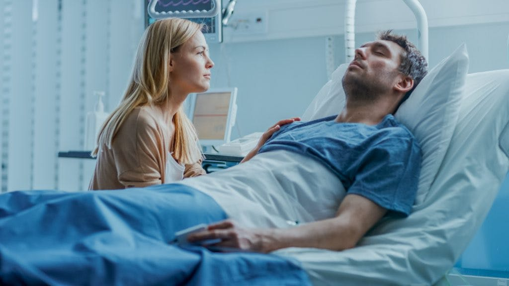 wife talking to husband who is in a coma
