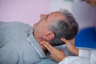 man receiving neck massage to help with post-concussion syndrome treatment