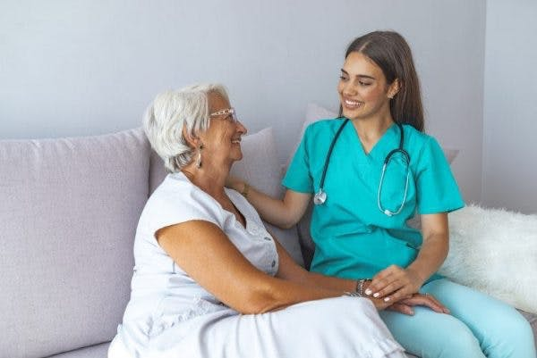 occupational therapist working with patient on sensory reeducation after stroke