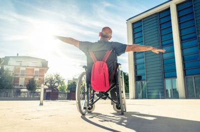 man in wheelchair looking at the sky wondering if tbi patients can fully recover