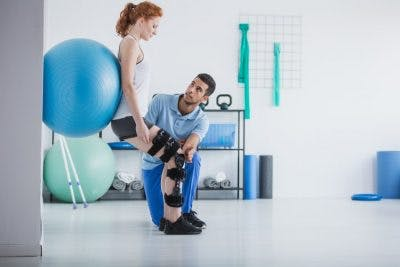 Girl working on physical therapy for paraplegia in order to walk again