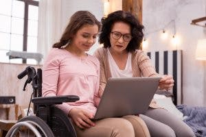 mother and daughter looking up spinal cord injury complications