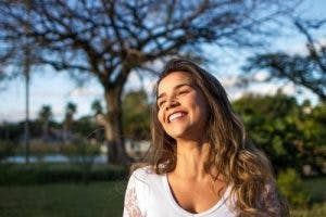 young woman smiling in sunlight