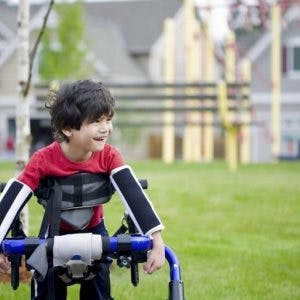 child with cerebral plasy using adaptive equipment to become more independent