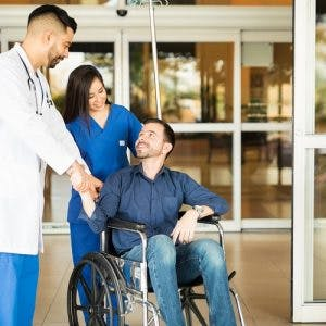 Patient leaving the hospital on a wheelchair after understanding complete vs incomplete spinal cord injury