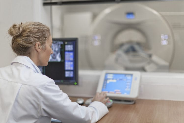 Doctor perform brain injury diagnostic tests on patient