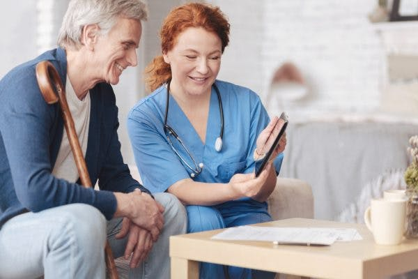 Therapist teaching man how to manage traumatic brain injury communication disorders