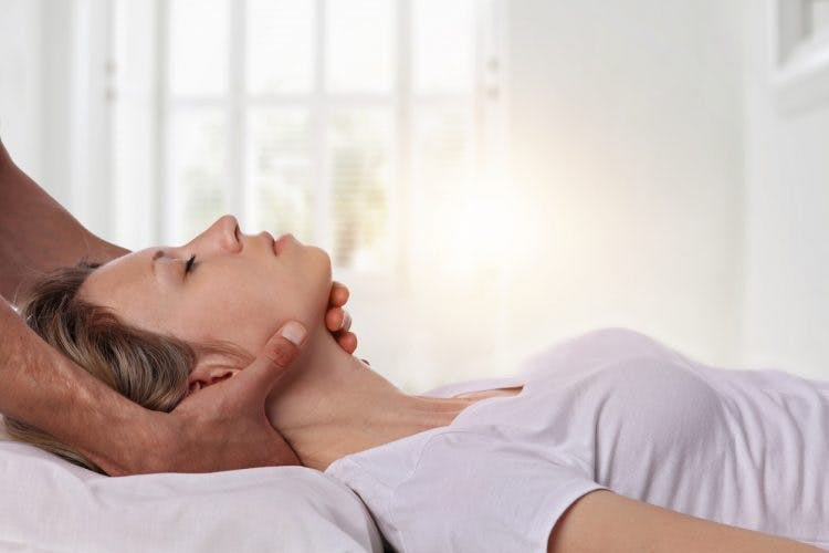 Woman trying craniosacral therapy for traumatic brain injury