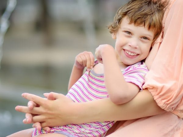 young girl with dyskinetic cerebral palsy smiling
