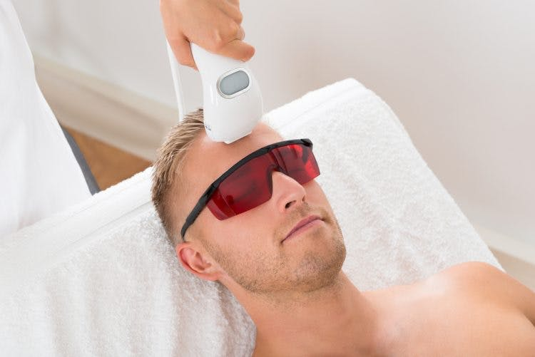 man trying cold laser therapy for brain injury