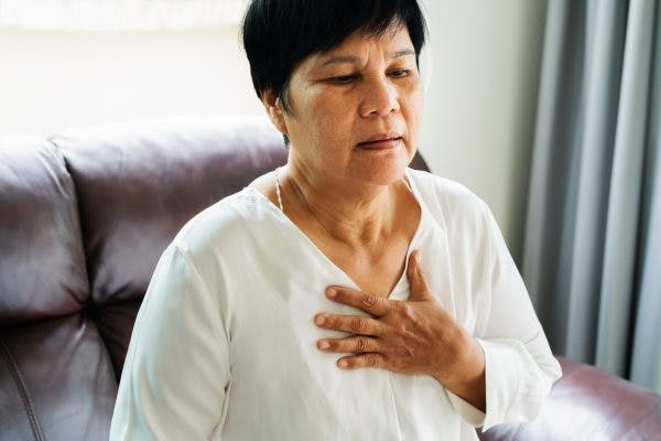 Older woman feeling the effects of autonomic dysfunction after concussion