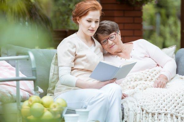 stroke survivor and caregiver reading the best stroke books