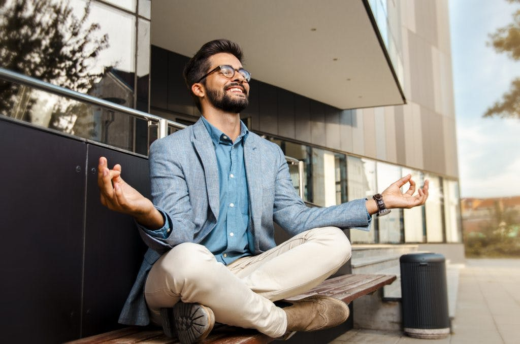businessman meditating to improve his attention