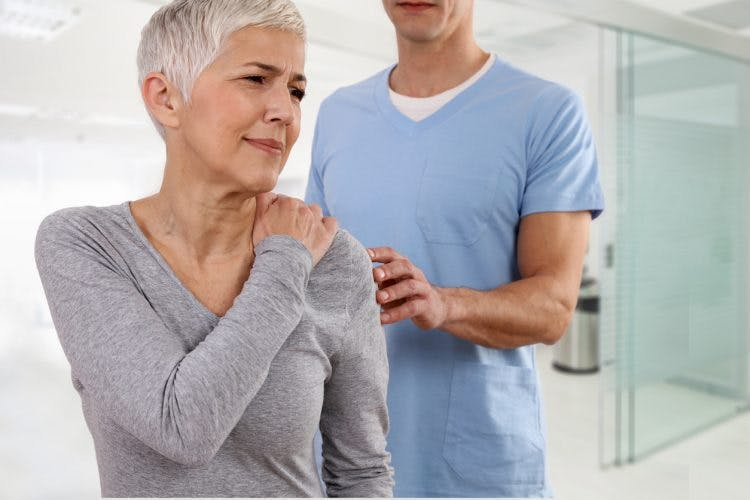 woman with muscle twitching after stroke working with physical therapist