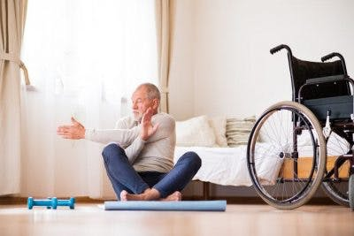 old man doing home therapy exercises for brain injury