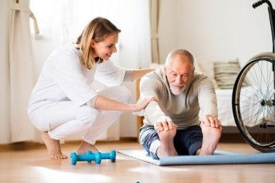 physical therapist working with stroke patient on tremor management