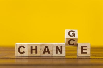 "Wooden cube with word ""Change & Chance"" concept on yellow background"