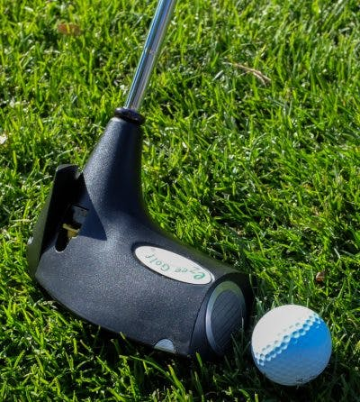 green grass with golf ball and club
