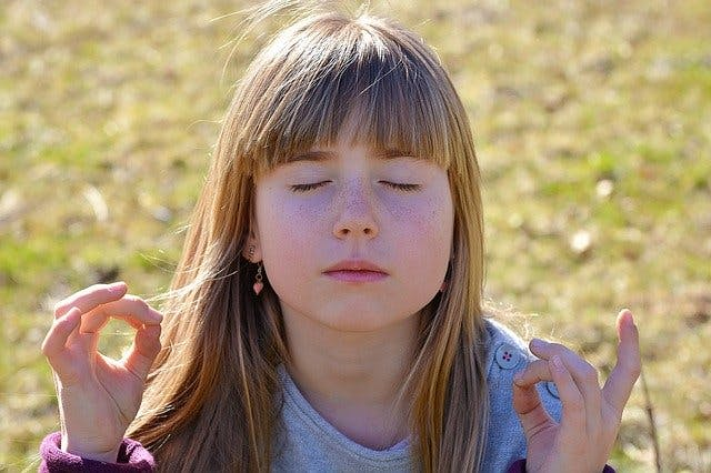 child using meditation for cerebral palsy psychological relief