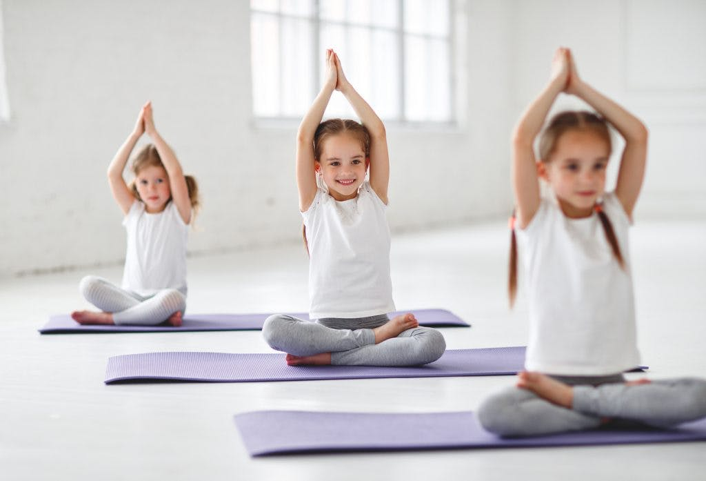 children trying yoga for cerebral palsy