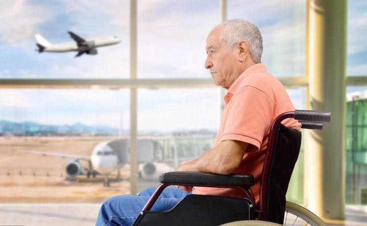 man waiting in airport terminal flying after stroke