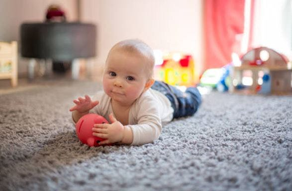 infant with cerebral palsy commando crawling