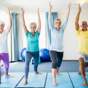 stroke patients doing gentle yoga poses at home
