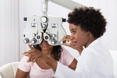doctor performing eye exam on patient to see if she has any vision loss after head injury