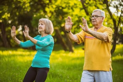 woman and man doing tai chi for stroke patients