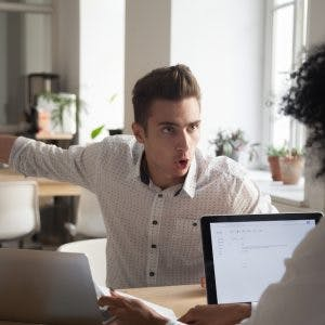 angry man yelling at coworker because he struggles with aggressive behavior after brain injury