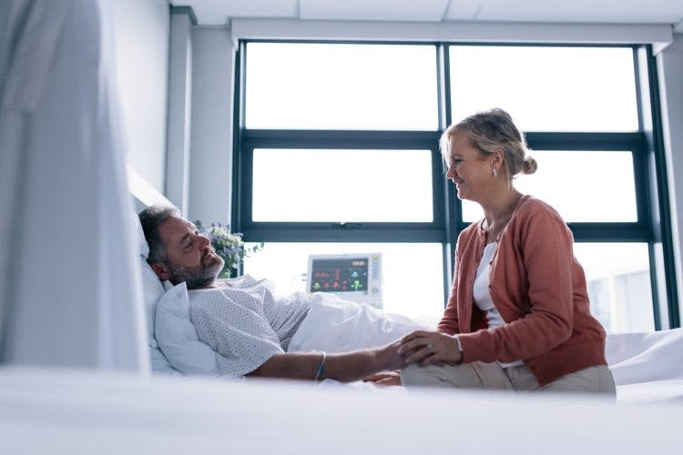Woman visiting husband with amnesia after head injury in hospital