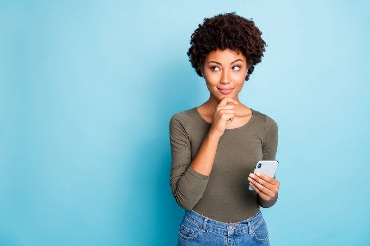 Woman Holding Phone and Thinking About Cognitive-Communication Therapy Activities