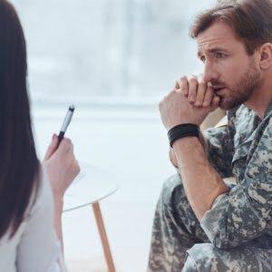 soldier listening to doctor describe blast-induced traumatic brain injury
