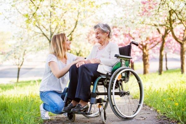 caregiver with basal ganglia stroke survivor