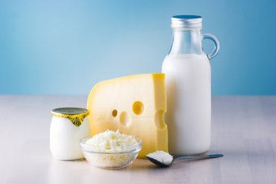 milk, cheese, yogurt sitting on table. dairy products are great sources of vitamin B12 for brain injury